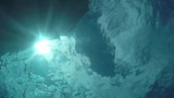Underwater with sun on surface looking up, sound and images of the ocean in the tropics. - 208434973