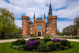 Moyland Castle entrance with driveway and flowers
