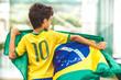 Quadro Brazilian Boy Holding The Flag of Brazil