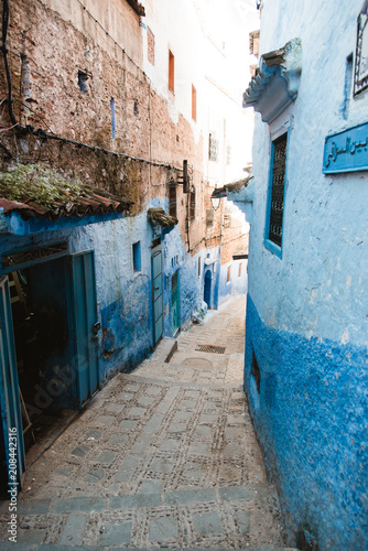 Fotobehang Smalle straatjes Blue Stone Buildings and Alley in Medina, Chefchaouen, Morocco