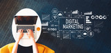 Digital Marketing with person using a laptop on a white table - 208453772