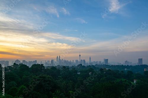 Aluminium Kuala Lumpur Cloudy sunrise over KL Tower and surrounded buildings in downtown Kuala Lumpur, Malaysia.