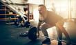 Leinwanddruck Bild - Focused mature man preparing to lift weights during a workout