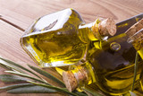 bottles of extra virgin oil on wooden background - 208466766