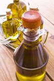 bottles of extra virgin oil on wooden background - 208466774