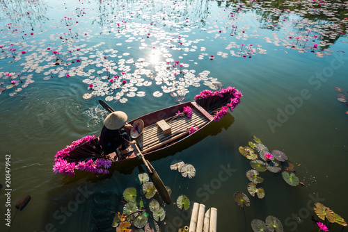 Plexiglas Pool Yen river with rowing boat harvesting waterlily in Ninh Binh, Vietnam