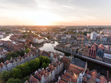 Photo of the old town of Gdansk architecture in sunset light. Aerial shot. Channel and buildings - top view - 208481931