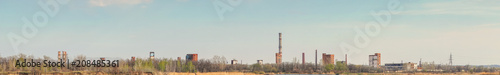 Fotobehang Oude verlaten gebouwen Panorama Old Abandoned chemical factory with chimneys on the banks of the river
