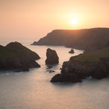 Stunning vibrant sunset landscape image of Kynance Cove on South Cornwall coast of England