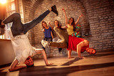 Young men performs break dancing moves - 208486957