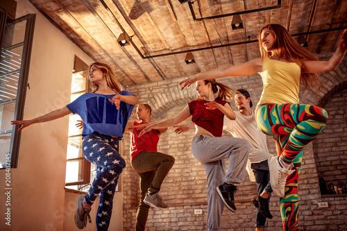 fototapeta na ścianę Passion dance team - dancer exercising dance training in studio