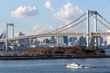 Tokyo Bay with Rainbow Bridge in Odaiba city skyline
