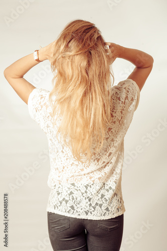 Portrait Of Beautiful Middle Age Blond Woman With Long Dyed Hair. Backside View