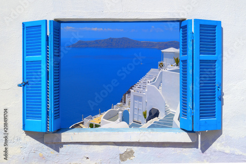 Fototapeta Sea view through traditional greek window in Santorini island