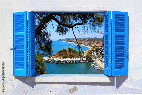 Leinwanddruck Bild Sea view through traditional greek window in Thassos island