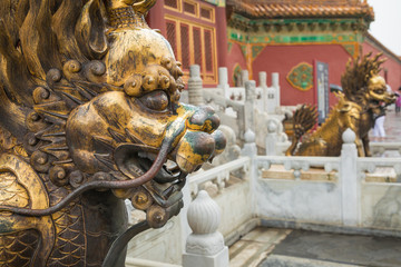 Bronze lion in front of the Hall of Supreme Harmony in Beijing Forbidden City, Forbidden City is one of China's landmarks © Curioso Photography