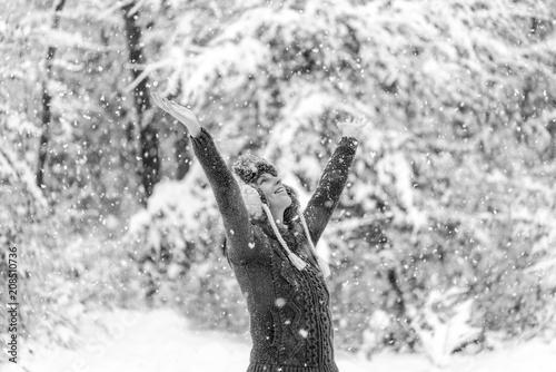 Young woman celebrating a winter snowfall