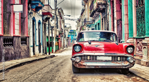 Old red Chevrolet car parked in a street of havana - 208521581
