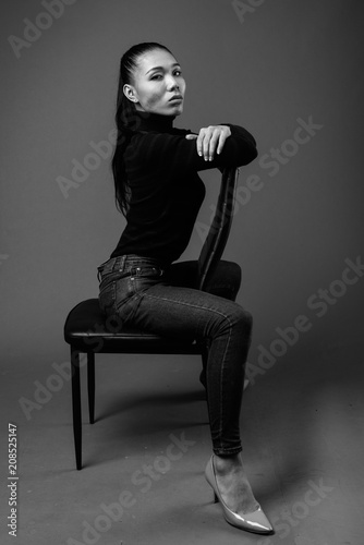 Black And White Portrait Of Asian Transgender Woman Sitting