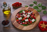 Cheese salad with tomatoes spinach and olives - 208527562