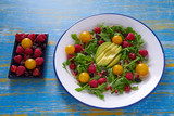 Avocado and berries salad with arugula and tomato - 208527574
