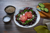 Tomato salad with seeds radish spinach lettuce - 208527586
