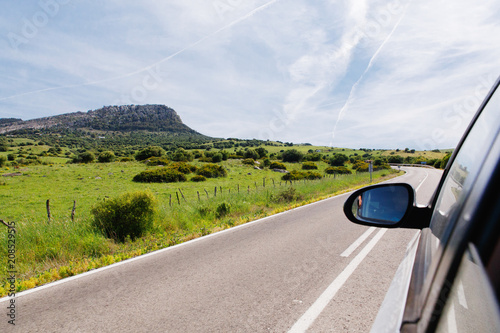 Car driving on a scenic road to the sea in spain.