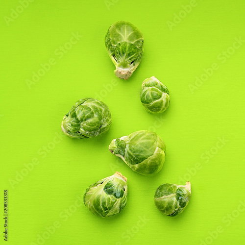 Fotobehang Brussel Food background flat lay, brussels sprouts on green background, top view.