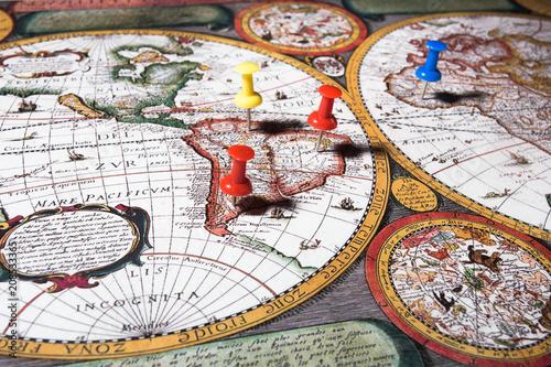 Fotobehang Wereldkaarten Colored Fasteners on World Map