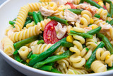 chicken pasta salad with green beans, red tomatoes and corn - 208533990