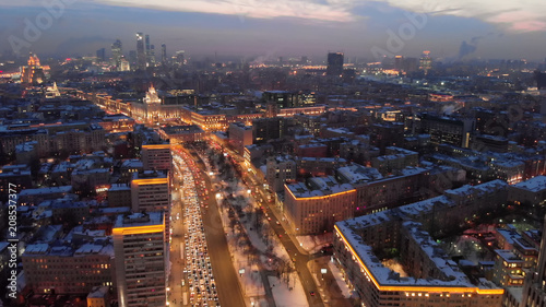 Fotobehang Moskou Aerial shooting of Moscow Garden Ring in the evening. City lights in the dusk. Business center