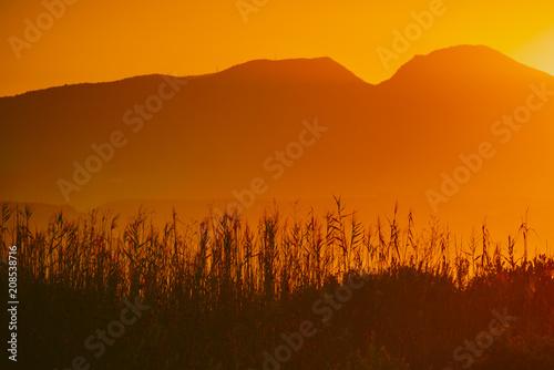 Fotobehang Bruin Sunrise over mountain hill
