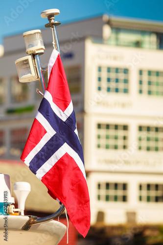 Foto Murales Norwegian flag city street in the background