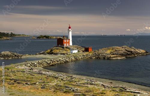 Fotobehang Vuurtoren Fisgard Lighthouse and Scenic Landscape View across Juan De Fuca Strait near Victoria, British Columbia Canada