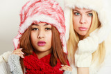 Two girls with winter outfit. - 208546550
