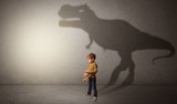I m dreaming about dinosaurus concept with cute little boy in an empty room