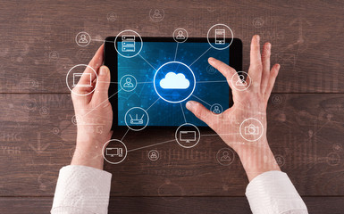 Hand touching tablet with cloud computing and online storage concept  © ra2 studio