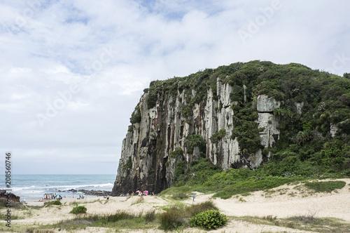 Guarita beach city Torres Brazil sand rock cliff ocean nature