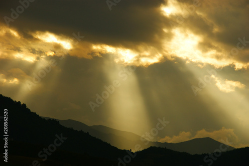 Fotobehang Zonsopgang clouds and mountains