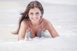 Leinwanddruck Bild - Woman laying at sea waves