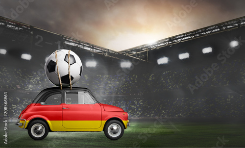 Leinwanddruck Bild Germany flag on car delivering soccer or football ball at stadium