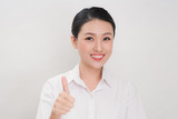 Asian business women are smiling and Thump up hand sign for working happy on white background - 208571726