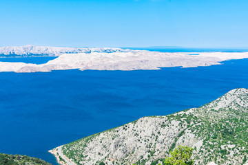 Seascape view of white stony islands in the clear blue Adriatic sea on a sunny day from above. Summer in Croatia or travel concept © Viktorija