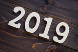 New year concept - Number 2019 for New Year on a wooden table. With vintage styled background. - 208574716