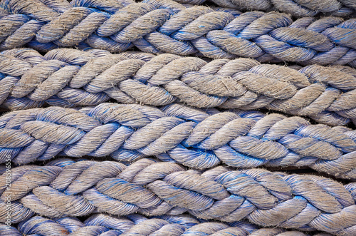 Fotobehang Schip Close up picture ofold frayed boat ropes, abstract background or texture.