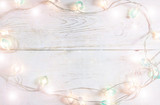 Beautiful christmas holiday background with soft lights on a white planks - 208608763