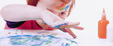 Great artist. Humorous photo of cute little child girl painting a picture (talent, art, creativity concept) - 208609147