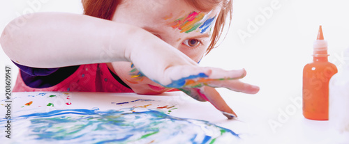 Foto Murales Great artist. Humorous photo of cute little child girl painting a picture (talent, art, creativity concept)