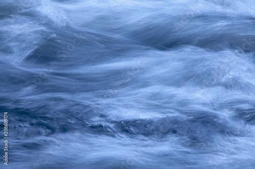 Fotobehang Bergrivier Long exposure shot of rapid mountain river. Water texture background.
