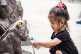 Little hospitality, Girl giving milk to animals - 208613981